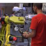 Photo of student operating equipment