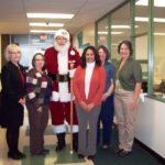 Photo of Buckeye HIlls staff with Santa Claus