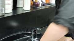 Photo of cosmetology student washing hair